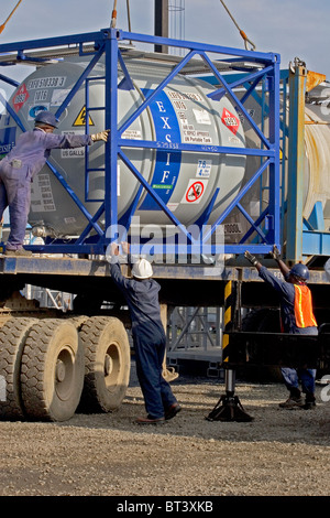 Luba Oil Freeport. Moving and loading chemical supplies in bunded area for use in offshore oil industry - Stock Photo