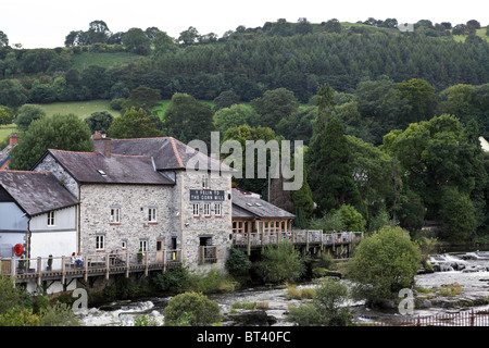 Viewed from Llangollen road bridge, here isThe Corn Mill situated on the south bank of the River Dee. - Stock Photo