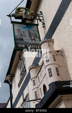 Traditional pub sign hanging outside a public house called the castle in a town in England. - Stock Photo