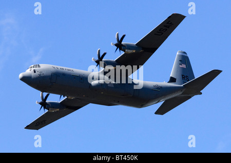 Lockheed C-130J Hercules operated by the US Air Force making a flypast at Farnborough Airshow - Stock Photo