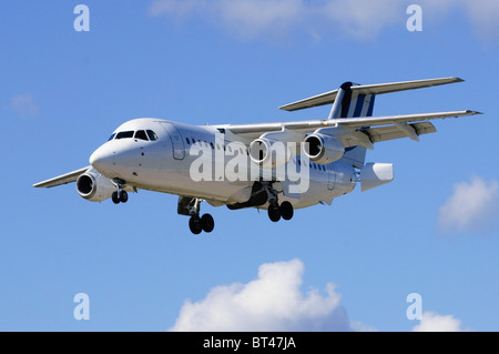 British Aerospace BAe 146-200 operated by BAE Systems on approach for landing at London Farnborough Airport - Stock Photo