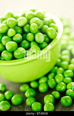 Closeup on bowl of fresh green organic green peas - Stock Photo
