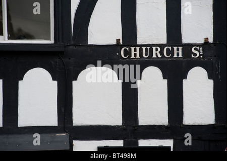 Street name on the side of an old half timbered building in the small market town of Wem in Shropshire, England. - Stock Photo