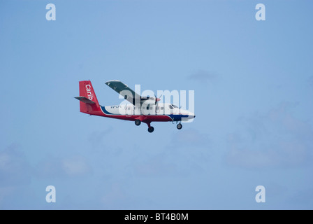 de Havilland Canada DHC-6, Twin Otter operated by Carib Aviation approaches to land - Stock Photo