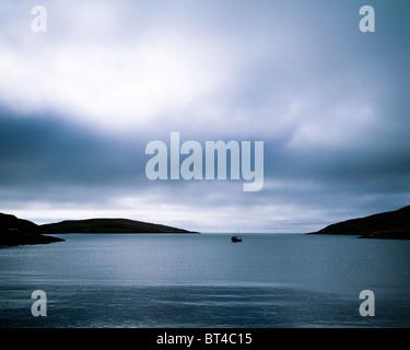 Dark light over Caolas Bhatarsaigh. Vatersay, Outer Hebrides. Scotland. - Stock Photo