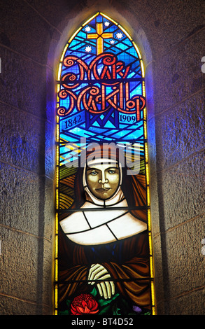 A stained glass window showing Mary McKillop, the australian canonised by Pope Penedict XVI - Stock Photo