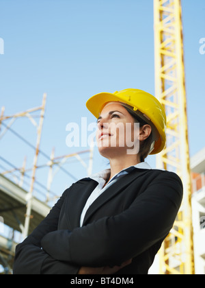 female engineer in construction site - Stock Photo