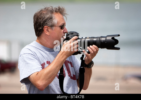 Professional Photographer Jim Reed scouts a photo in South Dakota, USA, June 3, 2010. - Stock Photo