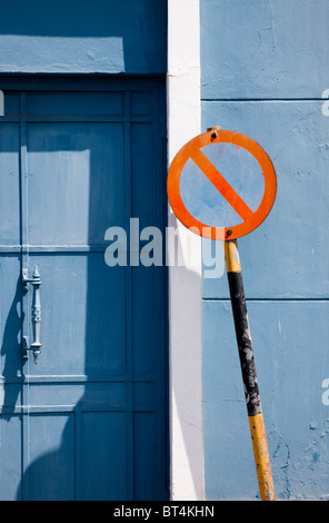 Road sign against a blue door and wall, Bridgetown, Barbados - Stock Photo