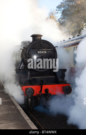 Making steam on uphill gradient. Restored Black 5 steam locomotive No. 45428 'Eric Treacy' at Grosmont Station, - Stock Photo