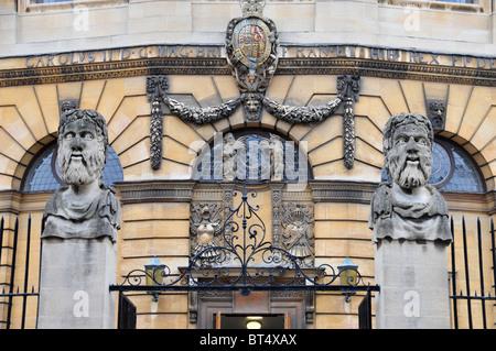 Gargoyles on railings outside the Sheldonian Theatre, Broad Street, Oxford - Stock Photo