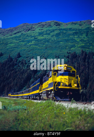 The Alaska Railroad train going through Girdwood, south bound. - Stock Photo