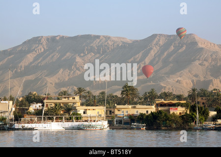 Hot air balloons over the Valley of the Kings, the West Bank of the Nile, Luxor, Upper Egypt - Stock Photo