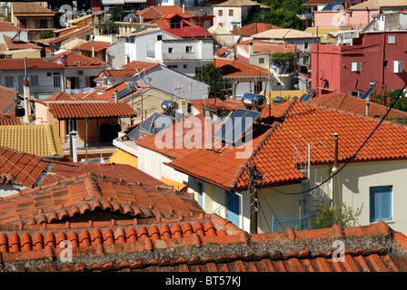 Solar Water Heating Panels on the Roofs of Houses in Parga, Epirus Greece. - Stock Photo