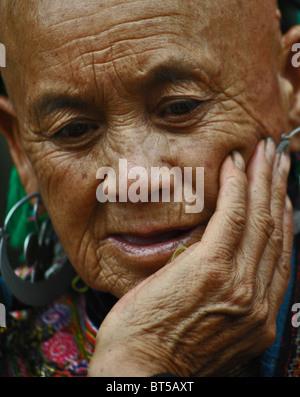 Elderly woman from the Flower Hmong tribe near Sapa, Vietnam - Stock Photo