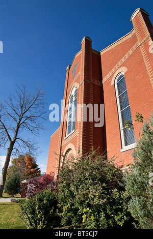 The front of a modern church, with orange brick, in Elora, Ontario, Canada - Stock Photo