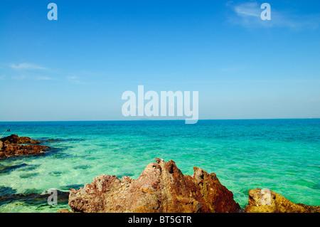Tropical landscape - sea shore on desert island - Stock Photo