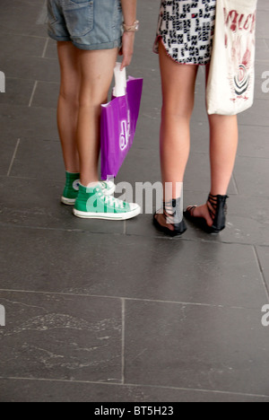 Innovative  Of Women Wearing Stylish Shoes Holding Shopping Bags  Stock Photo