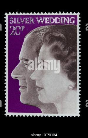 UNITED KINGDOM- CIRCA 1972: A stamp printed in Great Britain shows Queen Elizabeth II and Duke of Edinburgh, - Stock Photo