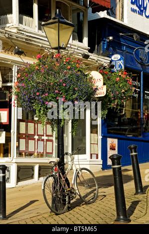 Bike leaning on lamp post Montpellier Parade Harrogate North Yorkshire England UK United Kingdom GB Great Britain - Stock Photo