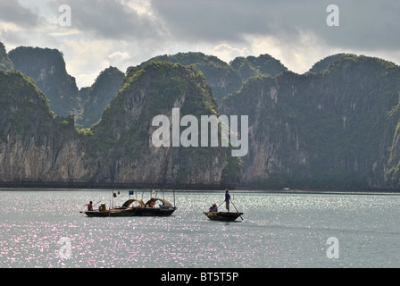 Boats in Halong Bay in the evening, Vietnam - Stock Photo