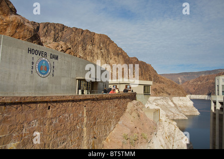 Visitors outside an exhibit hall at the Hoover Dam view the man-made and natural beauty - Stock Photo