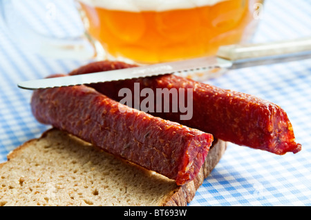 beer with a pair of Bavarian sausage - Stock Photo