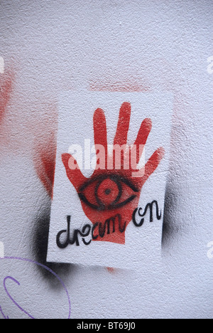 Graffiti Dream On fortune-telling sign on wall in Melbourne South Australia - Stock Photo