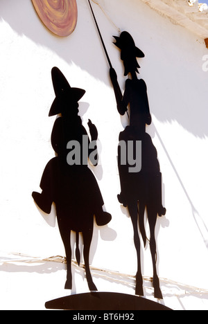 Silhouette of Don Quichote and his helper riding on horses. - Stock Photo