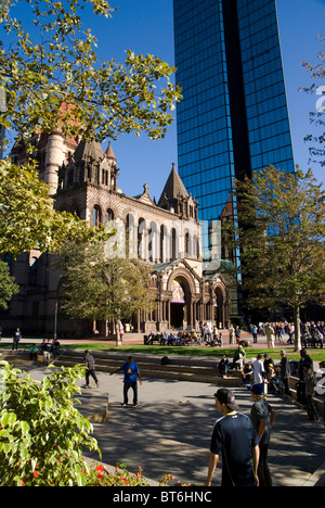 Youth skateboarding in front of Trinity Church, Copley Square, Boston - Stock Photo