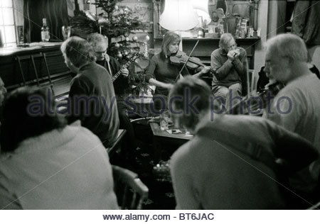 Folk musicians performing at Christmas time in the Prince Albert public house, in Stroud, Gloucestershire, UK. - Stock Photo