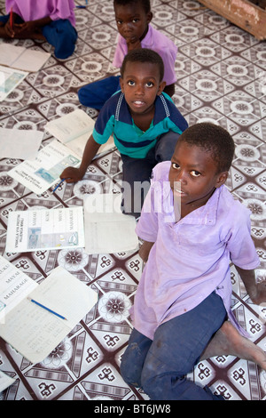 Jambiani, Zanzibar, Tanzania. Boys in Primary School. Students sit on the floor since the school has no furniture. - Stock Photo