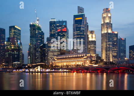 Singapore skyline at twilight, seen from the Esplanade - Stock Photo