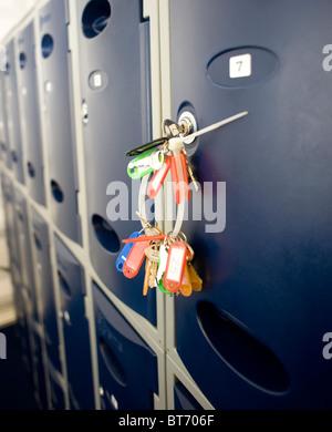 A bunch of keys in a locker door - Stock Photo