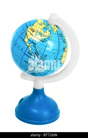 Small toy globe with South America and Atlantic Ocean isolated on white background - Stock Photo
