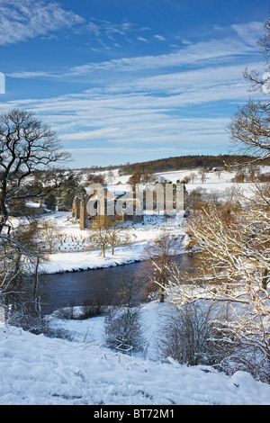 Bolton Priory next to the River Wharfe at Bolton Abbey, North Yorkshire. Winter - Stock Photo
