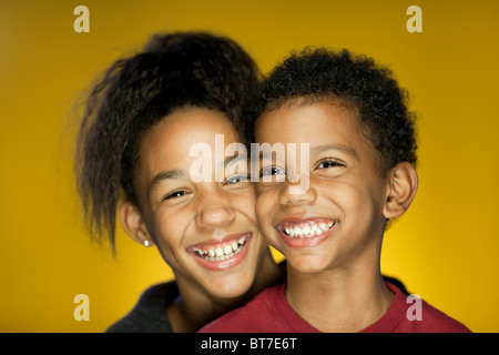 Portrait of Brother and Sister Smiling and having Fun - Stock Photo