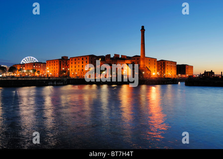 The buildings of the redeveloped Albert Dock complex in Liverpool as seen across Canning Dock. - Stock Photo