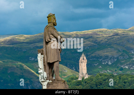 Statues of Robert the Bruce together with the Wallace monument seen from Stirling castle, Scotland, UK - Stock Photo