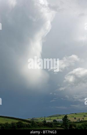 Towering cumulonimbus cloud moving away eastwards from the Culm valley area near Bradninch, Devon - Stock Photo
