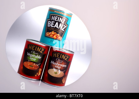 Cans of Heinz Baked Beans in Tomato sauce, Heinz Classic Vegetable Soup and Heinz Classic Cream of Mushroom Soup - Stock Photo