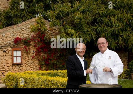 Winemaker Prof. Michael Popp, left, Peter Himbert, head chef of the Molí des Torrent restaurant, Santa María del - Stock Photo