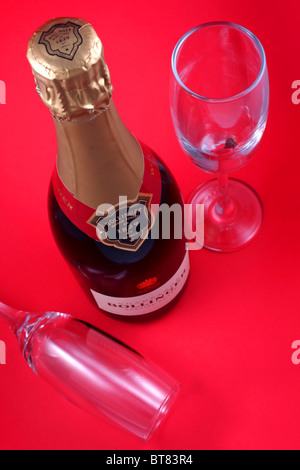 Bottle of Bollinger Special Cuvee Champagne with two glasses. - Stock Photo
