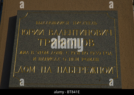 Plaque commemorating writer Juri Trifonov outside House on Embankment central Moscow Russia Europe - Stock Photo