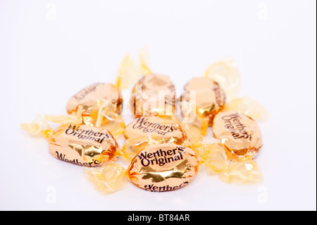 A close up photo of some Werthers Original butter candies sweets against a white background - Stock Photo