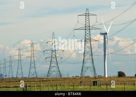 National Grid electricity transmission lines and pylons next to Nordex wind turbines at Little Cheyne Court wind - Stock Photo