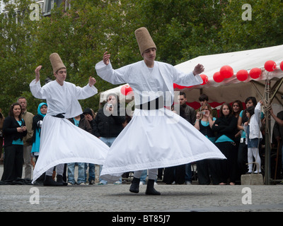 whirling dervishes give a display in Luxembourg City, Luxembourg - Stock Photo
