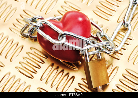 Heart in chains and padlock - Stock Photo