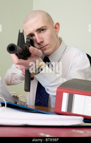 The chief accountant armed with a rifle - Stock Photo