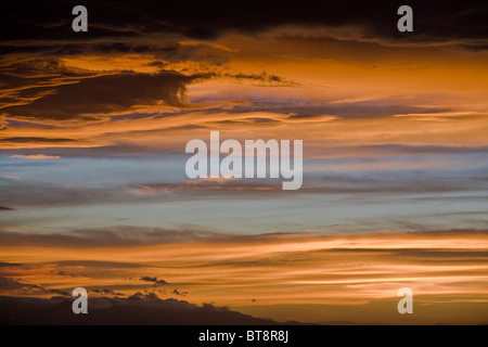 Golden sunset clouds background - Stock Photo